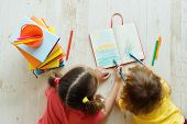Two  Girls Of Eight And Two Years Draw Colored Pencils, Play On A Floor. Childrens Creativity. Home poster