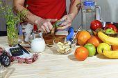 Detox. Woman Preparing Tasty Fruit Salad On Table. Preparing Healthy Breakfast. Sunny Morning. poster