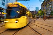 Manchester, England. Light Rail Yellow Tram In The City Center Of Manchester, Uk In The Evening. Mot poster