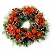 stock photo of christmas wreath  - Christmas wreath with green leaves pine cones apples flowers and red balls on a white background - JPG