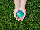 Earth Day. Earth In Hands And Green Grass Field Background. Environment Save Earth Concept. poster