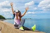 Young Woman Testing Vr Eyeglasses Outside. Female Wearing Virtual Reality Headset During Summer Weat poster