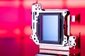modern CMOS  camera Image sensor. digital dslr camera cmos sensor removed from camera. poster