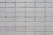 picture of arriere-plan  - white roughly textured brick wall painted with white paint - JPG