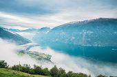 Sogn And Fjordane Fjord, Norway. Amazing Fjord Sogn Og Fjordane In Fog Clouds. Summer Scenic View Of poster