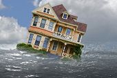 pic of flood  - house depicted in a flood with water and reflection - JPG
