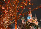 Moscow. Russia. New year entertainment on red square. Kremlin. St.Basil Cathedral. Red square is dec poster