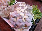 Top View Of Fresh Mantis Shrimp And Shrimp Topped With Fresh Garlic Sliced For Sale In Street Food A poster