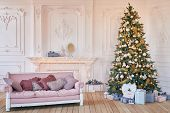 Luxury Living Room Interior With Sofa Decorated Chic Christmas Tree, Gifts And Pillows. Classic Inte poster