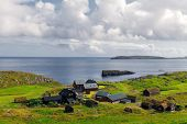 Summer view of small village with typical faroese turf-top houses on outskirts of Torshavn city, cap poster