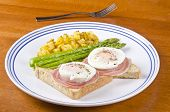 image of rutabaga  - Two poached eggs on thin slices of Pancetta over toasted wholewheat bread served with roasted asparagus and Rutabaga - JPG