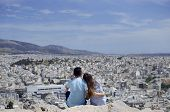 Romantic Couple Sightseeing Above Athens From Philosophical Mountain poster