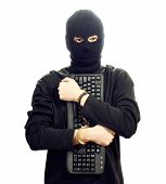 Hacker in black mask in handcuffs with keyboard isolated on white