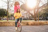 Happy Couple Riding On Bicycle In The City Center - Young People Having Fun Outdoor - Millennial Gen poster