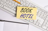 Word Writing Text Book Hotel. Business Concept For An Arrangement You Make To Have A Hotel Room Or A poster