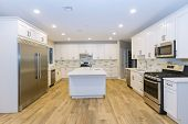 Three Kitchen Sinks In New Home With Island Sink Cabinets, And Hardwood Floors In New Luxury Home poster