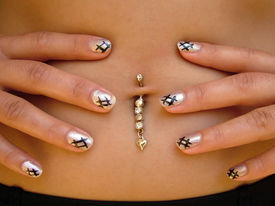 stock photo of pierced belly button  - A woman - JPG