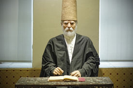 image of sufi  - Mannequin Of An Ottoman Sufi Dervish Studying Quran - JPG