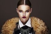 image of outerwear  - Beautiful Fashionable Strict Fashion Model in Fur Coat - JPG