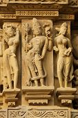 stock photo of kandariya mahadeva temple  - Sculptures of religious figures decorating the ancient Kandariya Mahadeva Hindu Temple at Khajuraho Uttar Pradesh India - JPG