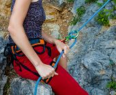 Woman Belays Climber In Mountain Closeup