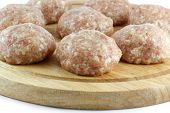 Balls of minced meat on a kitchen board