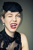 foto of cheeky  - A young woman in a black with her tongue out in a cheeky expression - JPG