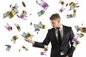 stock photo of glory  - Concept of a businessman that earns money - JPG