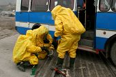 image of decontamination  - man in chemical suit for cleaning operation - JPG