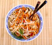 image of rice noodles  - Asian rice noodle with chicken meat and chopsticks top view - JPG