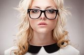 stock photo of freckle face  - closeup horizontal portrait of blonde young beautifulwoman wearing eyeglasses - JPG
