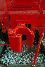 picture of caboose  - A coupling on a caboose painted bright red - JPG
