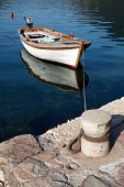 White Wooden Fishing Boat Floats Moored In Perast Town, Montenegro