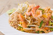 stock photo of rice noodles  - Pad Thai Koong dish of stir fried rice noodles