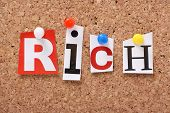 pic of possession  - The word Rich in cut out magazine letters pinned to a cork notice board - JPG