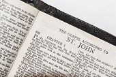stock photo of biblical  - Holy Bible opened at St John - JPG