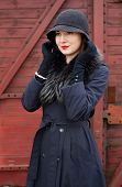 picture of have sweet dreams  - Woman adjusts a black hat - JPG