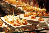 stock photo of buffet lunch  - Some tapas in a bar in Espana  - JPG