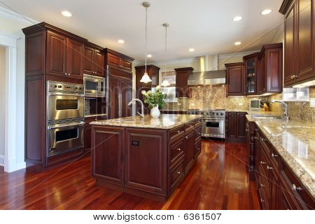 poster of Kitchen With Cherry Wood Cabinetry