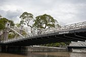 SINGAPORE - NOVEMBER 05, 2012: Pedestrian Cavenagh Bridge is the only suspension bridge,it is the ol