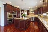 image of interior  - Kitchen in luxury home with cherry wood cabinetry - JPG