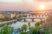 View at bridges across the river Vltava in Prague at dusk