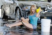 picture of car wash  - A blonde model washes her car at a local car wash - JPG