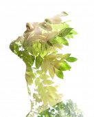 stock photo of combine  - Creative double exposure portrait of young man combined with photograph of nature - JPG