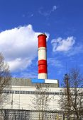 foto of chp  - High factory chimney over blue sky background - JPG