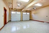 stock photo of track home  - Empty garage with roller door - JPG