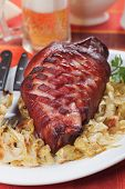 Roasted pork knuckle with sauerkraut, traditional german meal