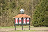 stock photo of pigeon loft  - Large rustic pigeon house in a grassland agains forest - JPG