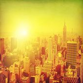 Grunge image of New York City Manhattan skyline at sunset.