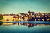 Vintage retro hipster style travel image of Mala Strana and  Prague castle over Vltava river with gr